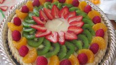 Create any pattern with berries and fruit.  My tarts are never the same - I let the colors, shapes and flavors guide me.