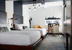 Painted stripes continue from ceiling down to meet the headboards. / The Renwick Hotel a New York