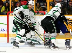The puck deflects up in front of Dallas Stars defenseman Jamie Oleksiak (5) during the NHL game between the Nashville Predators and the Dallas Stars, held at Bridgestone Arena in Nashville, Tennessee.