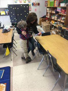 Mrs. Kinney hugging a student