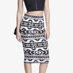 Express Aztec print midi Trendy Aztec print in the perfect length skirt means you can go with a crop top on weekends and a blouse during the work week. Pre loved with love left. Modern shape meets ancient Aztec inspiration to form a midi skirt with graphic impact. It wraps your curves in soft, comfortable stretch cotton fabric and decks you out in a look that's destined for raves. Wear reflected in discounted price. Labeled XS, fits S Express Skirts Midi
