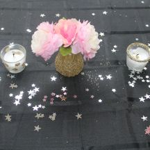 Black table cloths, star confetti, glitter votives, glitter shakers, paper peonies  Girly and whimsical Under the Stars Party  A SPARKLE FACTOR LLC