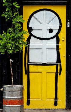 Street Art-STIK - 119 Bethnal Green Road, London I want the same on my door. Door Entryway, Entrance Doors, Doorway, Cool Doors, Unique Doors, Bethnal Green, When One Door Closes, Yellow Doors, Earthship