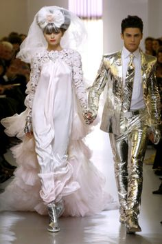 Abbey Lee and Giabiconi with the bride in lace and silk while the groom shone in gold foil.