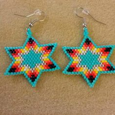"""38 Likes, 1 Comments - Lisa Ladouceur-Fraser (@metisgirlbeads) on Instagram: """"Turquoise Fire Star #earrings #star #fire #beads #beading #handcrafted #aboriginal #metis…"""""""