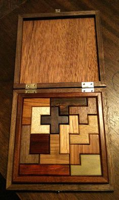 this beautiful, artful, coloful and supple wood puzzle from howard fink and love that it is self-contained Wooden Projects, Wood Crafts, Diy And Crafts, Wood Games, Puzzle Box, Scroll Saw Patterns, Wood Creations, Wooden Puzzles, Wood Toys