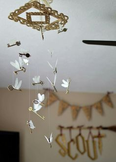 Once again, the attention to detail is the cherry on top for me. The replication of the flying keys from Harry Potter is so neat and accurate too. Baby Harry Potter, Harry Potter Baby Shower, Deco Harry Potter, Harry Potter Thema, Harry Potter Nursery, Harry Potter Classroom, Theme Harry Potter, Harry Potter Birthday, Harry Potter Mirror