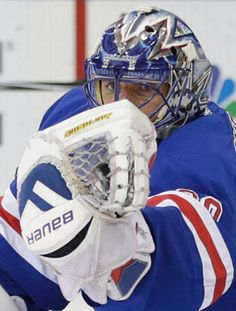New York Rangers goalie Henrik Lundqvist grabs a shot by the Tampa Bay Lightning during the first period of Game 5 of the Eastern Conference final during the NHL hockey Stanley Cup playoffs, Sunday, May 24, 2015, in New York. (AP Photo/Frank Franklin)
