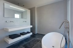 Bring Ibiza to your relaxing white minimalist bathroom with this exquisite modern freestanding Corian bathtub SALINAS by #COCOON   Corian washbasin Float 120 with Inox Stainless Steel basin taps by Dutch designer brand COCOON    All #COCOON bathroom taps are both available via inoxtaps.com and via byCOCOON.com   Bathroom design & bathroom renovation for businesses, hotels and private clients byCOCOON.com    Badkamer ontwerp & verbouwing byCOCOON.nl
