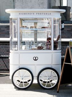 Sigmund's Pretzel Cart - classic style pretzel cart in soft grey blue with glass display case, black wheels and black signage