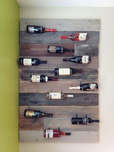 Handmade, wall-mounted wine rack  This wine rack is made of pine and measures approximately 3'x5'. Holds 12 bottles, although I could also make one that would be smaller and hold 6   Custom-made iron wine bottle hooks.   For the wine rack in the picture, stain the wood to give it an antique, reclaimed look.