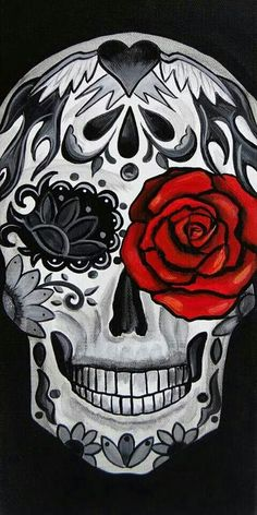 Sugar skull with one red rose in eye.