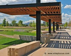 Wood and steel pergola structure at Belmar in Lakewood, Colorado. www.sitephocus.com