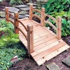 This is the type of bridge I want out front in the garden area I would like to have.