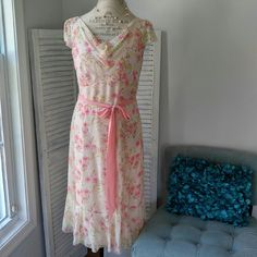 Ann Taylor feminine floral Silk dress. Pretty in Pink.  Fully lined silk dress.  Fabric is lightweight and drapes beautifully. Delicate hem.  Hidden side zipper.  Bust:  37 inches  Waist:  32 inches  Length:  41 3/4 inches measures from shoulder seam to bottom of hem. Ann Taylor Dresses