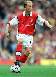 """Dennis Bergkamp was selected by Pelé as one of the FIFA 100 greatest living players and is widely regarded as one of the greatest players in his generation. In 2007, he was inducted into the English Football Hall of Fame, the first and so far only Dutch player ever to receive such honour. Bergkamp has also finished third in the FIFA World Player of the Year award twice. Due to his fear of flying, Bergkamp has been affectionately nicknamed the """"Non-Flying Dutchman"""" by Arsenal supporters."""