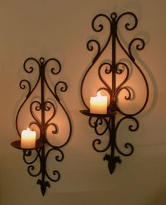 pair of wrought iron wall candle holders dark brown wide