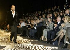 TOM FORD  The former Gucci and Yves Saint Laurent creative director—now the force behind his own eponymous label and beauty brand—was known at the time of his induction for oozing immaculately tailored, high-glamour sex appeal, as you can tell by his open-shirted march down a zebra catwalk.