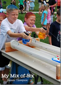 Used spray bottles to squirt boats - make track out of pvc cut in half or rain g. Used spray bottles to squirt boats – make track out of pvc cut in half or rain gutters with end caps … ti Youth Games, Games For Kids, Backyard Games, Outdoor Games, Fall Festival Games, Fete Ideas, Outside Games, Summer Fair, Fair Games