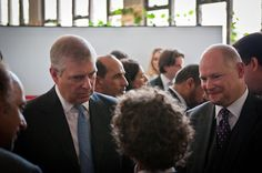 Prince Andrew and Jonathan Miller talking to a student