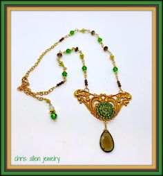 Classic French Gold winged base with 20mm vintage peridot Swarovski crystal focal and a Smoky Quartz  drop and matching crystals in neckline Leaf Necklace, Necklace Set, Necklace Lengths, Beaded Necklace, Filigree Ring, Smoky Quartz, Peridot, Swarovski Crystals, Jewelery