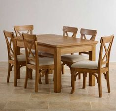 50% OFF Taunton Rustic Brushed Solid Oak Dining Set with 4ft 7 Extending Dining Table and 6 Beige Fabric Chairs.