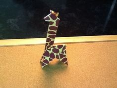 Origami: Giraffe  Designed by: Hiroaki Takai  Made by: Heather  ----------  Today's origami lesson is three hundred and forty-six in the series. We are going to continue a new kit that includes lots of cool safari/jungle animals before we finish up with bugs - just in time for summer!  Today's animal is a giraffe.  These origami are easier so they u...