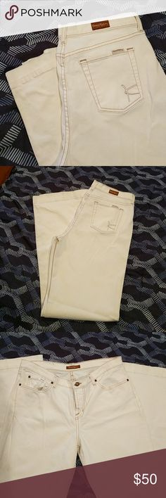 David Kahn White Bootcut Jeans David Kahn White Bootcut Jeans. Never worn. There is a little dirt on the hem of legs due to trying them on. These would be geat with  heels or boots! David Kahn Jeans Boot Cut