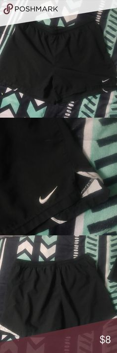 Nike shorts Black nike shorts. Small white stain on the back very hard to see unless you're close up. Offers welcome Nike Shorts