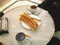 Churros - If beignets mated with French fries and then you poured melted chocolate all over them. YUM.
