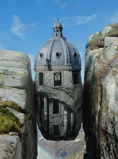 "France, ""house between the rocks"" along La Cote de Granit Rose in Brittany near Plougrescant."