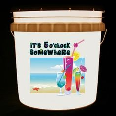 This bucket light features a collection of tropical drinks and the words It's 5 O'Clock Somewhere in a bright, floral print.
