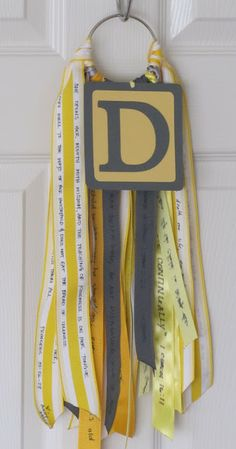 Baby Shower Craft Idea - Guests are asked to bring a bible verse or saying or prayer for the baby, then they are all written on ribbons and connected to a ring for a door or wall decoration.** Would also be cute for a wedding!