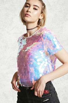 bc7bd582689 A mesh top featuring allover iridescent sequins