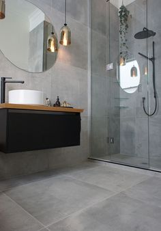 Concrete looking tile — they used a large format tile called Cementia Grey 75 (Step Design Bathroom)