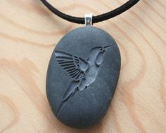 Hummingbird necklace -  Hand engraved humming bird beach stone necklace - Tiny PebbleGlyph Pendant (c). $20.00, via Etsy.