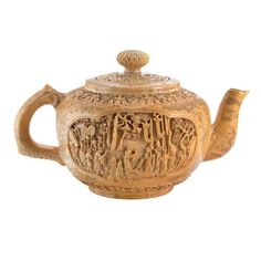 Ivory teapot    China, 17th century    Doyle Auctions, the kind of teapot you'll never use :)