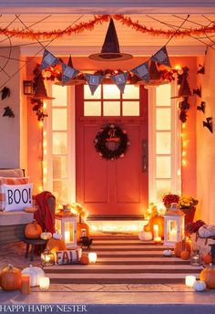 What a fun and spooky Halloween Porch. Add some witches hats, paper bats, and a homemade spider web to the decor. Learn how to make a giant spider web using yarn in this helpful tutorial.