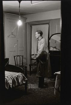 Diane Arbus, Man in Room.  See The Virtual Artist gallery: www.thesrtistobjective.com