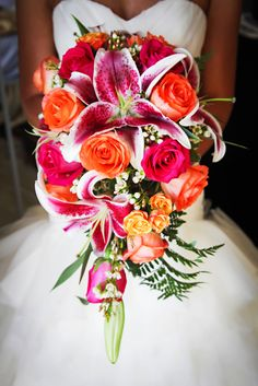 Stargazer Lily and Hot Pink Rose Bouquet | Limelight Photography https://www.theknot.com/marketplace/limelight-photography-tampa-fl-424515