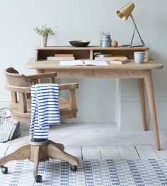 Our solid oak mid-century Phineas desk with our wooden Blofeld wheelie chair