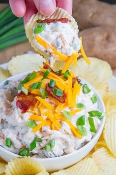 Loaded Baked Potato Dip ~ All of the classic loaded baked potato flavours including sour cream, cheese, bacon and green onions in dip form just waiting to be scooped up by some crispy potato chips... the combination of the dip and the potato chips is quite amazing!