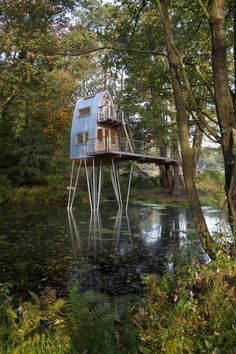 Rounded Treehouse Tower Solling by Baumraum Architects in Uslar, Germany built in 2010 over a man made pond. Photos © Markus Bollen