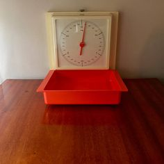Wall hanged scale from 1960s Sweden by NilsJohan a great retro piece in orange and white.     If you have a compact kitchen in retro style and need a scale then this wall hanged scale from 1960s Sweden by the great company NilsJohan is the best you can get.  It is in good vintage condition and is easy to hang up and the tray is easy to take of and clean, the scale is o to 3 kilos (3000 g).  A great piece to decorate your kitchen or as a present.