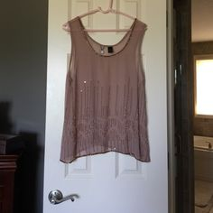 BKE Boutique top Worn a few times. Good condition, some strings may be coming loose but does not affect beading. Light beige color, very sheer. BKE Tops Tank Tops