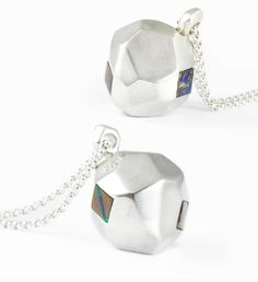 237 shows that looking up gives you endless possibilities. Three boulder opal squares are set around this multi-dimensional pendant suspended on a long, round link cable chain.   http://www.urbanboulder.com/necklaces/large-237-necklace