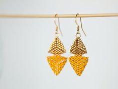 Items similar to Speckled double triangle earrings - gold and yellow, beaded geometric earrings with miyuki delica beads (ID: on Etsy Handmade Bracelets, Earrings Handmade, Handmade Jewelry, Etsy Jewelry, Jewellery, Yellow Earrings, Beaded Earrings, Gold Earrings, Handmade Shop