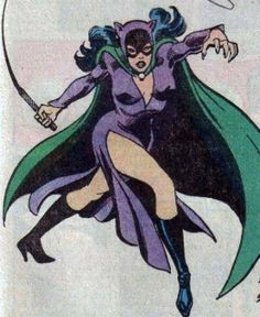 I always wondered why in the movies she wears all black when in the comics she wears purple