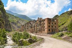 Abandoned village in subtropical Ossetia- such a waste.  subtropical means warm, doesn't it?   Sadon & Hadon were villages destroyed (5 storey buildings in VILLAGES???) by mudslides in 2002 which also flooded the nonferrous metallurgy mines.