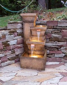 great way to add that 'backyard habitat' water feature when we build the retaining wall in the backyard